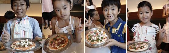 出来上がったピッツァと一緒に「ハイ、ポーズ」。どの子もとってもいい笑顔。焼き上がりが楽しみですね!